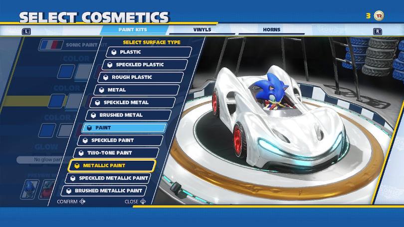 Väljer färger på Sonics bil. Blått, vtt och rött ska det bli.